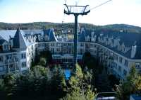 View of the Marriott Hotel from the free open gondola-type lift called The Cabriolet, which connects the upper and lower parts of the pedestrian village. From the top of this lift the main gondola is available to take skiers to the summit of the mountain. September 2007