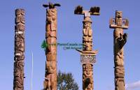 Highlight for Album: Totem Poles Photos - Gitanyow was formerly named Kitwancool. The band government changed its name from the Kitwancool Indian Band to the Gitanyow Indian Band in 1991.    New Aiyansh, Northern British Columbia, Canada, First Nation Stock Photos